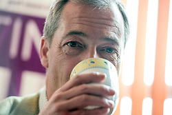 © Licensed to London News Pictures. 29/04/2014. Slough, UK NIGEL FARAGE leader of UKIP in The Lynchpin Public house in Slough today 29 April 2014 whilst meeting to congratulate local activists on more than doubling the candidates the party will field in local elections. Photo credit : Stephen Simpson/LNP