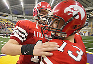 City High quarterback AJ Derby (18) and wide receiver John Chelf (13) celebrate their win after their Class 4A semifinal game at the UNI Dome in Cedar Falls on Friday November 13, 2009.