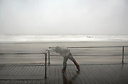 Eleven-year old Michael Leitner of Ocean Township braces himself against the strong winds along the boardwalk in Asbury Park during the dangerous conditions of Hurricane Sandy on October 29. Hurricane Sandy continued on its path Monday, forcing the shutdown of mass transit, schools and financial markets, sending coastal residents fleeing for higher ground, and threatening a dangerous mix of high winds and soaking rain.