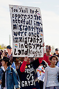 19 JANUARY 2009 -- PHOENIX, AZ: A man carries a sign showing support for immigrants during the Martin Luther King Jr. Day march in Phoenix. About 500 people marched three miles through Phoenix, Monday Jan. 19, in memory of Dr. Martin Luther King Jr. This year the march also marked Jan 20 inauguration of Barack Obama as the US President.   PHOTO BY JACK KURTZ