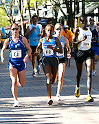 Roger Crowley/Times Argus.Caroline Chemwolo of Kenya (389) captured the individual women's title in the 20th Annual KeyBank Vermont City Marathon Sunday in Burlington. Two-time defending champion Heidi Westerling of New Hampshire (F1) placed third.