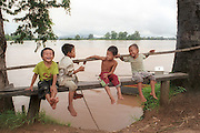 Khone Falls, Laos-- Aug 20, 2004  Children from a fishing village along the Khone Falls which  stradles the borders between  Cambodia and Laos kid around as the adults in the village go about the business of  selling and buying the catch of the day.   photo by essdras m suarez/glboe staff