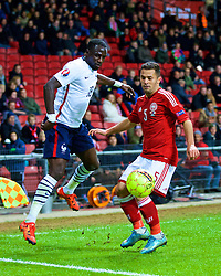 COPENHAGEN, DENMARK - Sunday, October 11, 2015: Denmark's Riza Durmisi in action against France's Moussa Sissoko during the friendly game at Parken Stadium. (Pic by Lexie Lin/Propaganda)