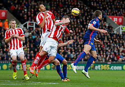 Michael Carrick of Manchester United heads a cross past the Stoke City defence to set up a goal for Radamel Falcao to make it 1-1 - Photo mandatory by-line: Rogan Thomson/JMP - 07966 386802 - 01/01/2015 - SPORT - FOOTBALL - Stoke-on-Trent, England - Britannia Stadium - Stoke City v Manchester United - New Year's Day Football - Barclays Premier League.
