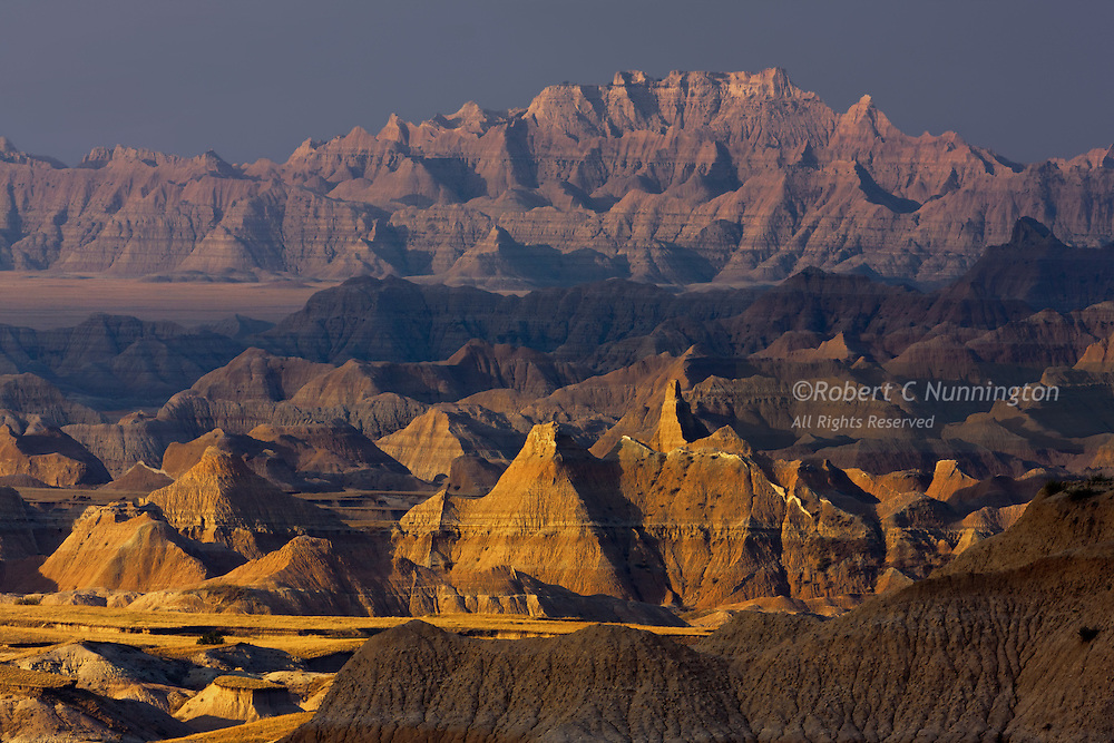 Wildfires in neighboring Nebraska create a smog which render unusual morning colors over the Badlands in South Dakota