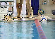 Iowa City High's Lizzie Brown (from left) greets Cedar Rapids Kennedy's Brooke Timmerman after the 100 yard breaststroke event at the Girls' High School State Swimming & Diving Championships at the Marshalltown YMCA/YWCA in Marshalltown on Saturday, November 9, 2013. Brown placed first with a time of 1:03.86 and Timmerman placed ninth with a time of 1:08.23.