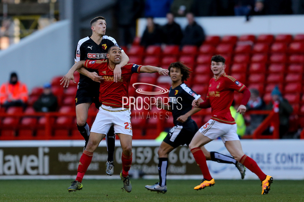 Watford defender Craig Cathcart  and Nottingham Forest forward Dexter Blackstock battle for the header during the The FA Cup fourth round match between Nottingham Forest and Watford at the City Ground, Nottingham, England on 30 January 2016. Photo by Simon Davies.