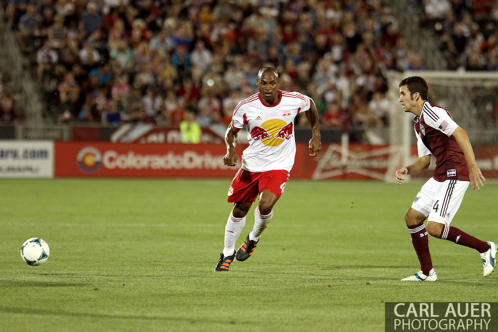July 4th, 2013 - New York Red Bulls defender Jamison Olave (4) passes the ball away from Colorado Rapids midfielder Nathan Sturgis (24) in second half action of the Major League Soccer match between New York Red Bulls and the Colorado Rapids at Dick's Sporting Goods Park in Commerce City, CO