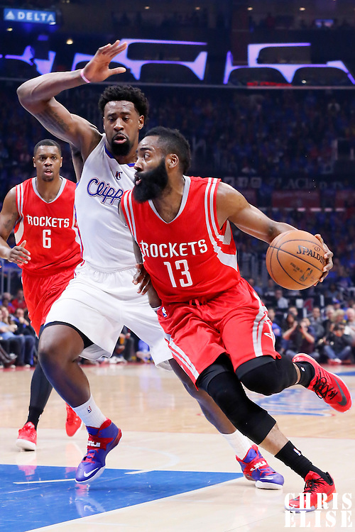 14 May 2015: Houston Rockets guard James Harden (13) drives past Los Angeles Clippers center DeAndre Jordan (6) during the Houston Rockets 119-107 victory over the Los Angeles Clippers, in game 6 of the Western Conference semifinals, at the Staples Center, Los Angeles, California, USA.