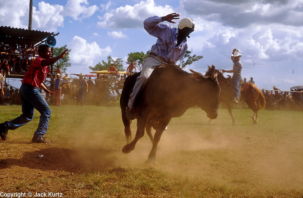 28 JULY 2002 - JOVELLANOS, MATANZAS, CUBA: Bullriding at an amateur rodeo in the town of Jovellanos, province of Matanzas, Cuba, July 28, 2002..PHOTO BY JACK KURTZ
