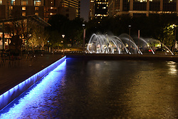 Stock photo of Discovery Green's fountains at night