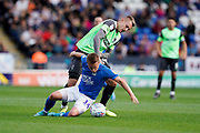 Joe Pigott of AFC Wimbledon keeps the pressure on Louis Reed of Peterborough United during the EFL Sky Bet League 1 match between Peterborough United and AFC Wimbledon at London Road, Peterborough, England on 28 September 2019.
