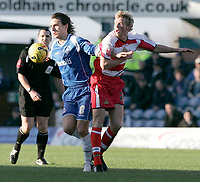 Photo: Dave Howarth.<br />Oldham Athletic v Doncaster Rovers. Coca Cola League 1.<br />13/11/2005.Oldham's Mark Hughes passes Doncaster's Paul Green
