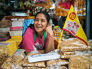 27 SEPTEMBER 2016 - BANGKOK, THAILAND: A vendor waits for customers in the market in the Samut Songkhram train station. The train from Baen Laem to Samut Songkhram (Mae Khlong) recently resumed service. The 33 kilometer track was closed for repair for almost a year. In Samut Songkhram, the train passes over the market. Vendors pull their stands out of the way and people step out of the way as the train passes through the market. It is one of the most famous train stations in Thailand and has become an important tourist attraction in the community.     PHOTO BY JACK KURTZ