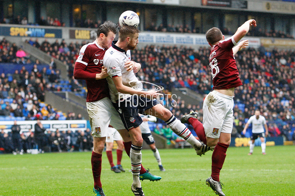 Bolton Wanderers Mark Beevers (5) gets to the ball ahead of Northampton Towns Zander Diamond (5) during the EFL Sky Bet League 1 match between Bolton Wanderers and Northampton Town at the Macron Stadium, Bolton, England on 18 March 2017. Photo by Craig Galloway.