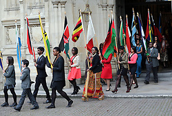 Commonwealth flag bearers  leaving  the annual Commonwealth Observance at Westminster Abbey in London, Monday, 10th March 2014. Picture by Stephen Lock / i-Images
