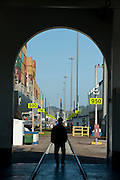 View of cargo ships from an arch door. Miraflores Locks, Panama Canal, Panama City, Panama, Central America.