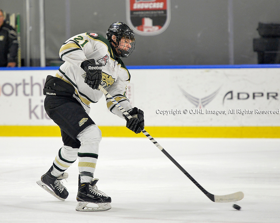 BUFFALO, NY - SEP 27, 2016:  Ontario Junior Hockey League game between Cobourg and St. Michael's, Matthew Carroll #21 of the Cobourg Cougars shoots the puck during the pregame warm-up.<br /> (Photo by Shawn Muir / OJHL Images)