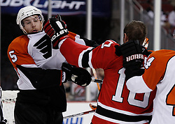 Oct 3, 2009; Newark, NJ, USA; New Jersey Devils center Rod Pelley (10) hits Philadelphia Flyers defenseman Braydon Coburn (5) with a left hand during the second period at the Prudential Center.