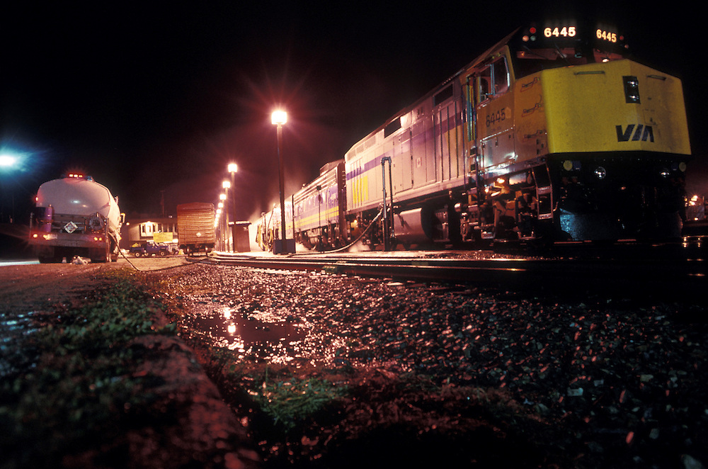 Canada, British Columbia, VIA Rail passenger train takes on diesel fuel and water at station in Revelstoke