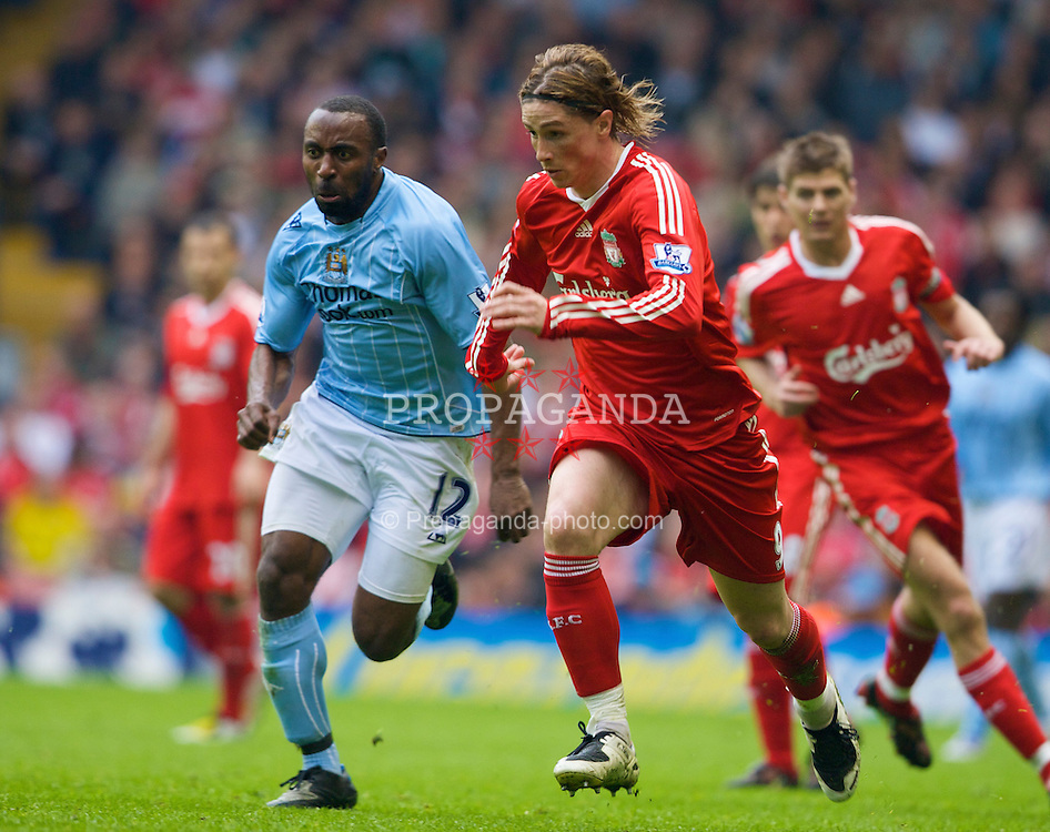 LIVERPOOL, ENGLAND - Sunday, May 4, 2008: Liverpool's Fernando Torres and Manchester City's Darius Vassell during the Premiership match at Anfield. (Photo by David Rawcliffe/Propaganda)