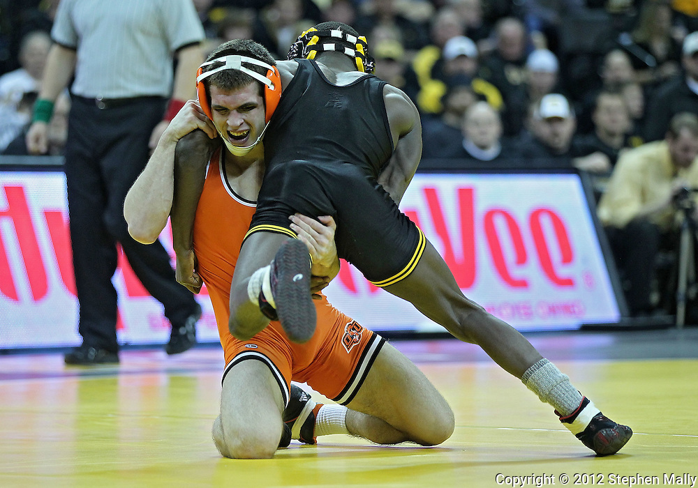 January 07, 2011: Oklahoma State's Josh Kindig and Iowa's Montell Marion struggle of control during the 141-pound bout in the NCAA wrestling dual between the Oklahoma State Cowboys and the Iowa Hawkeyes at Carver-Hawkeye Arena in Iowa City, Iowa on Saturday, January 7, 2012. Marion won 9-7.