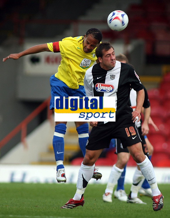 Photo: Paul Thomas.<br /> Grimsby Town v Hereford United. Coca Cola League 2. 08/10/2006.<br /> <br /> Tamika Mkandawire (L) of Hereford battles with Gary Jones.