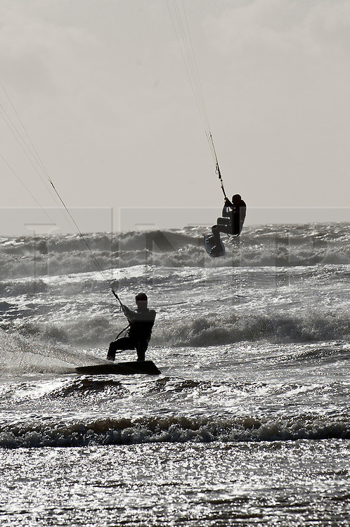 © Licensed to London News Pictures. 15/02/2014. Rest bay, Porthcawl, Bridgend. Kitesurfers enjoy the wind and waves as the storm passes over. Photo credit : Graham M. Lawrence/LNP
