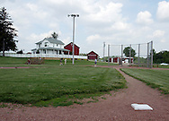 Tourists live their dreams on the Field of Dreams movie site near Dyersville, Iowa.  The baseball field and house played a key role in the 1989 movie.