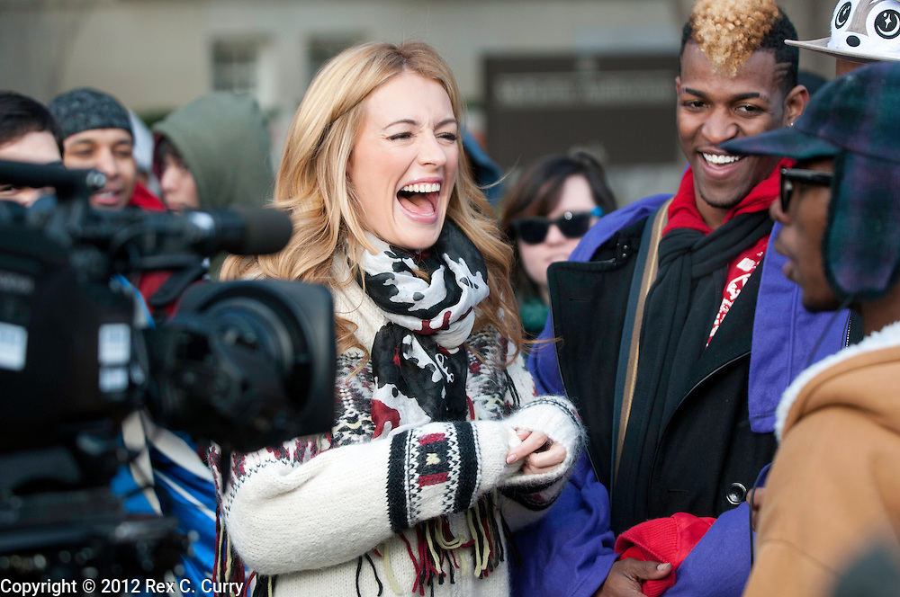 "Cat Deeley, left, host of ""So You Think You Can Dance"" laughs with hopeful contestants as they waited in the early morning cold to audition at SMU on Friday, Jan. 13, 2012."