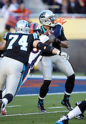 Carolina Panthers tackle Mike Remmers (74) blocks as Carolina Panthers quarterback Cam Newton (1) drops back to pass while the outstretched arm of Denver Broncos outside linebacker Von Miller (58) hits Newton's arm causing a fumble that gets recovered in the end zone by Denver Broncos defensive end Malik Jackson (97) for a touchdown good for a 10-0 Broncos lead during the NFL Super Bowl 50 football game against the Denver Broncos on Sunday, Feb. 7, 2016 in Santa Clara, Calif. The Broncos won the game 24-10. (©Paul Anthony Spinelli)