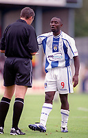 Lomana Lua Lua (Colchester) argues his way into a yellow card from referee R. Beeby. Colchester United v AFC Bournemouth. League Division Two, 2/9/00. Credit Colorsport / Nick Kidd.