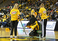 February 11 2013: Iowa Hawkeyes mascot Herky watches as the Libman floor cleaners work during a timeout in the first half of the NCAA women's basketball game between the Nebraska Cornhuskers and the Iowa Hawkeyes at Carver-Hawkeye Arena in Iowa City, Iowa on Monday, February 11 2013.