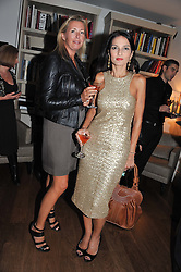 Left to right, TIGGY KENNEDY and YASMIN MILLS at a dinner hosted by Marlon and Nadya Abela in aid of Kids Company at Morton's, Berkeley Square, London on 25th September 2012.