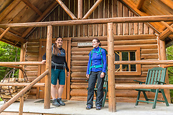Two women on the front porrch of a cabin at the Appalachian Mountain Club's Little Lyford Lodge in Maine's 100 Mile WIlderness.