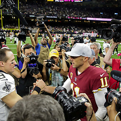 Oct 8, 2018; New Orleans, LA, USA New Orleans Saints quarterback Drew Brees (9) and Washington Redskins quarterback Alex Smith (11) talk following a game at the Mercedes-Benz Superdome. The Saints defeated the Redskins 43-19.