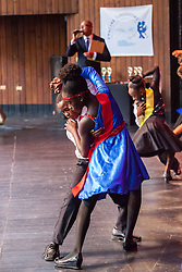 "Lockhart and E. Benjamin Oliver students compete witht the tango.  Dancing Classrooms Virgin Islands students compete in ""Colors of the Rainbow"" team match competition at Reichhold Center for the Arts.  St. Thomas, USVI.  9 May 2015.  © Aisha-Zakiya Boyd"