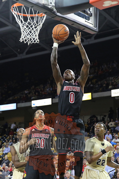 Louisville Guard Terry Rozier shoots the ball during an NCAA basketball game between the 14th ranked Louisville Cardinals and the UCF Knights at the CFE Arena on Tuesday, December 31, 2013 in Orlando, Florida. (AP Photo/Alex Menendez)