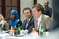 07 MAY 2013, BERLIN/GERMANY:<br /> Mahada Wayah, Delegierte der Jungen Islam Konferenz, Hans-Peter Friedrich, CSU, Bundesinnenminister, Benedikt Erb, Delegierter der Jungen Islam Konferenz, (v.L.n.R.), waehrend der Uebergabe des Empfehlungskataloges der Jungen Islam Konferenz an die Deutsche Islam Konferenz, vor Beginn der Plenarsitzung der Deutschen Islam Konferenz, DIK, Humbold Caree<br /> IMAGE: 20130507-01-027<br /> KEYWORDS: Sitzung, Plenum, Übergabe, Empfelungen