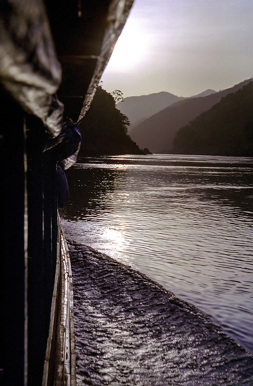 The side of a boat going up the Mekong river in Laos, at sunset, 2003.