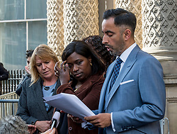 Kadi Johnson, sister of Sheku Bayoh, watches as the family's lawyer Aamer Anwar reads a statement following their meeting with the Lord Advocate.<br /> <br /> <br /> &copy; Dave Johnston / EEm