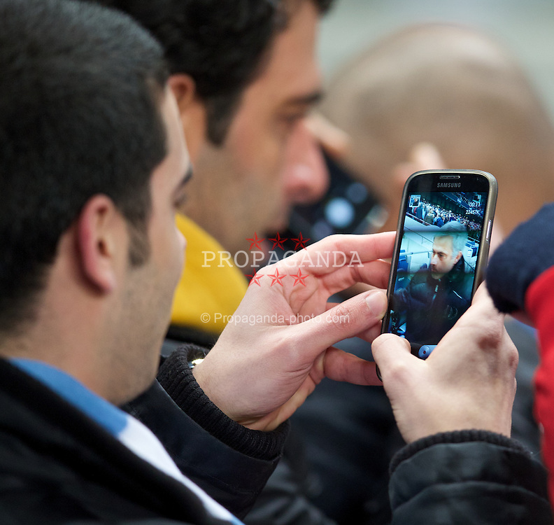 MANCHESTER, ENGLAND - Monday, February 3, 2014: Chelsea's manager Jose Mourinho poses for fans' selfie photographs before the Premiership match against Manchester City at the City of Manchester Stadium. (Pic by David Rawcliffe/Propaganda)