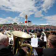 A REQUIEM FOR THE FOGHORN, PERFORMED BY SEVENTY FIVE BRASS PLAYERS, A FOGHORN AND AN ARMADA OF SHIPS<br /> A project by Danish artist, Lise Autogena, in collaboration with Joshua Portway and composer Orlando Gough. <br /> Ships horns from an armada of vessels off-shore, seventy five brass players on-shore and the Souter Lighthouse Foghorn  performed a Foghorn Requiem, an ambitious musical performance to mark the disappearance of the sound of the foghorn from the UK's coastal landscape.<br /> Conducted and controlled from a distance, ships at sea sounded their horns to a musical score, that will took into account landscape and the physical distance of sound. The performance took place by Souter Light House by South Shields, UK with thousands of spectators and more than 50 ships off-shore.