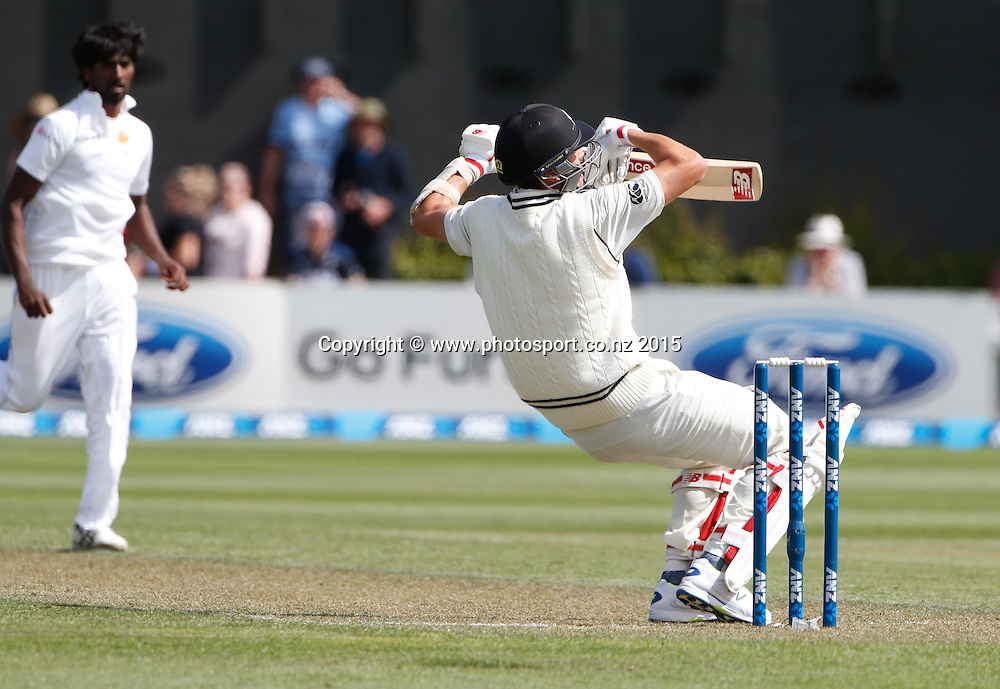 Trent Boult takes a tumble avoiding a bouncer.  First day, second test, ANZ Cricket Test series, New Zealand Black Caps v Sri Lanka, 03 January 2015, Basin Reserve, Wellington, New Zealand. Photo: John Cowpland / www.photosport.co.nz