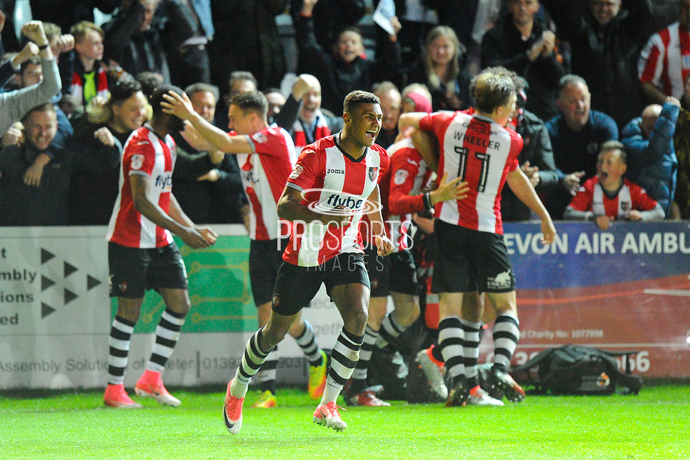 Ollie Watkins (14) of Exeter City runs away in delight as Jack Stacey (28) of Exeter City celebrates scoring a goal to make the score 3-2 during the EFL Sky Bet League 2 play off second leg match between Exeter City and Carlisle United at St James' Park, Exeter, England on 18 May 2017. Photo by Graham Hunt.