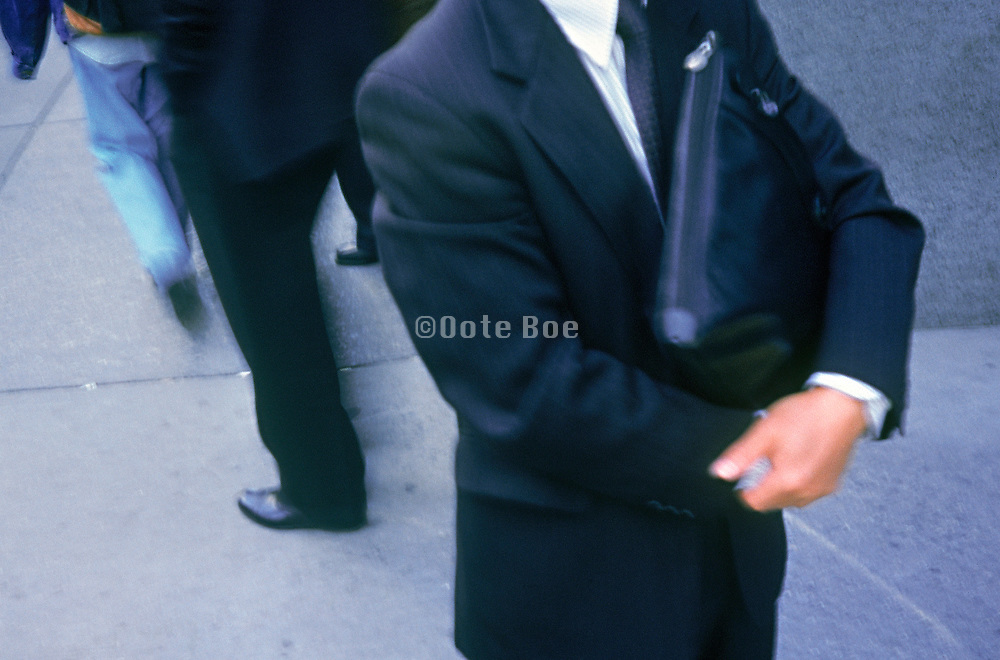 An executive with his arms crossed holding a briefcase