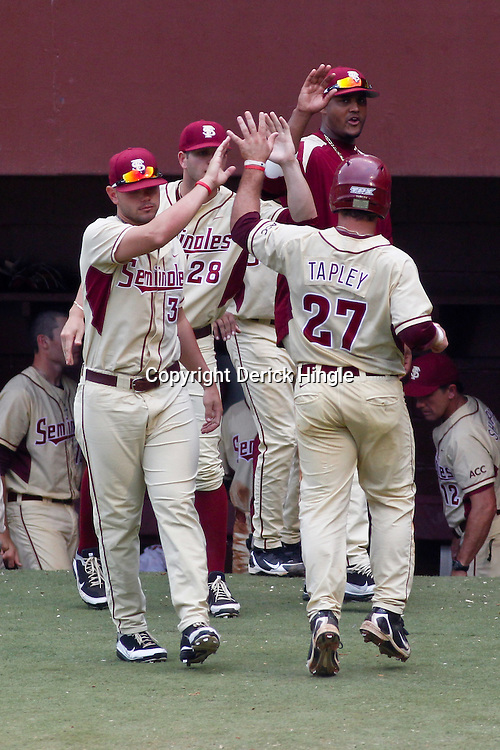 June 05, 2011; Tallahassee, FL, USA; Florida State Seminoles left fielder Stuart Tapley (27) celebrates with teammates after scoring  against the Alabama Crimson Tide during the fourth inning of the Tallahassee regional of the 2011 NCAA baseball tournament at Dick Howser Stadium. Mandatory Credit: Derick E. Hingle