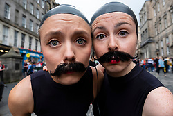 Edinburgh, Scotland, UK; 2 August, 2018. On day before official opening of the Edinburgh Festival Fringe 2018, performers are active on the Royal Mile handing out fliers and meeting the public. Pictured; Lucille and Cecilia from Bang Average Theatre, performing a surreal comedy sea lion play.