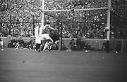 Down goalie P. Kelly caught off guard the ball goes toward goal but ball went wide during the All Ireland Senior Gaelic Football Final Kerry v Down in Croke Park on the 22nd September 1968. Down 2-12 Kerry 1-13.