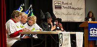 "The ""Senior Moments"" team of Judy Dean, Mendon MacDonald and Doris Citron go up against the HTS ""SPELLcasters"" during Lakes Region Scholarship Foundation's 13th annual Spelling Bee at Laconia High School Thursday evening.  (Karen Bobotas/for the Laconia Daily Sun)"